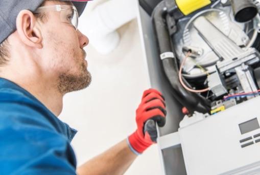 Plumber repairing boiler